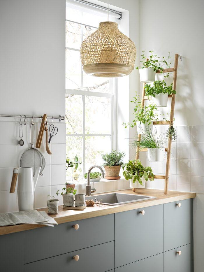 A harmonious grey-green BODARP kitchen