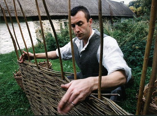 weaving a fence at the Ulster Folk & Transport Museum