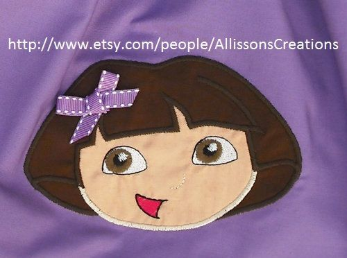Dora  with Birthday hat and plain  machine by Designsembroidery, $3.49