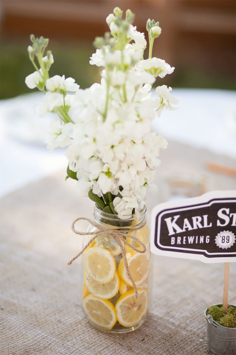 Lemons In A Jar With Flowers For Spring Table Decoration Wedding