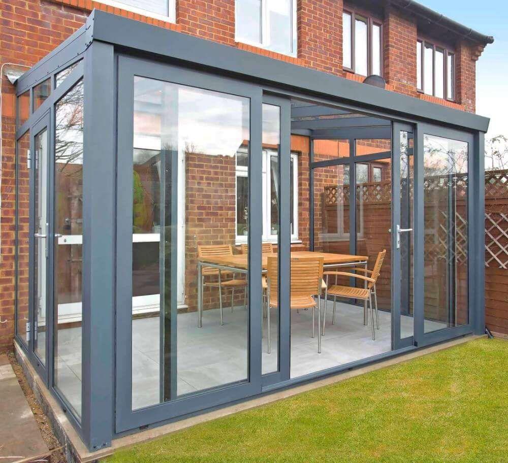 Gartenzimmer mit Glasdach und 4teiliger Schiebetür