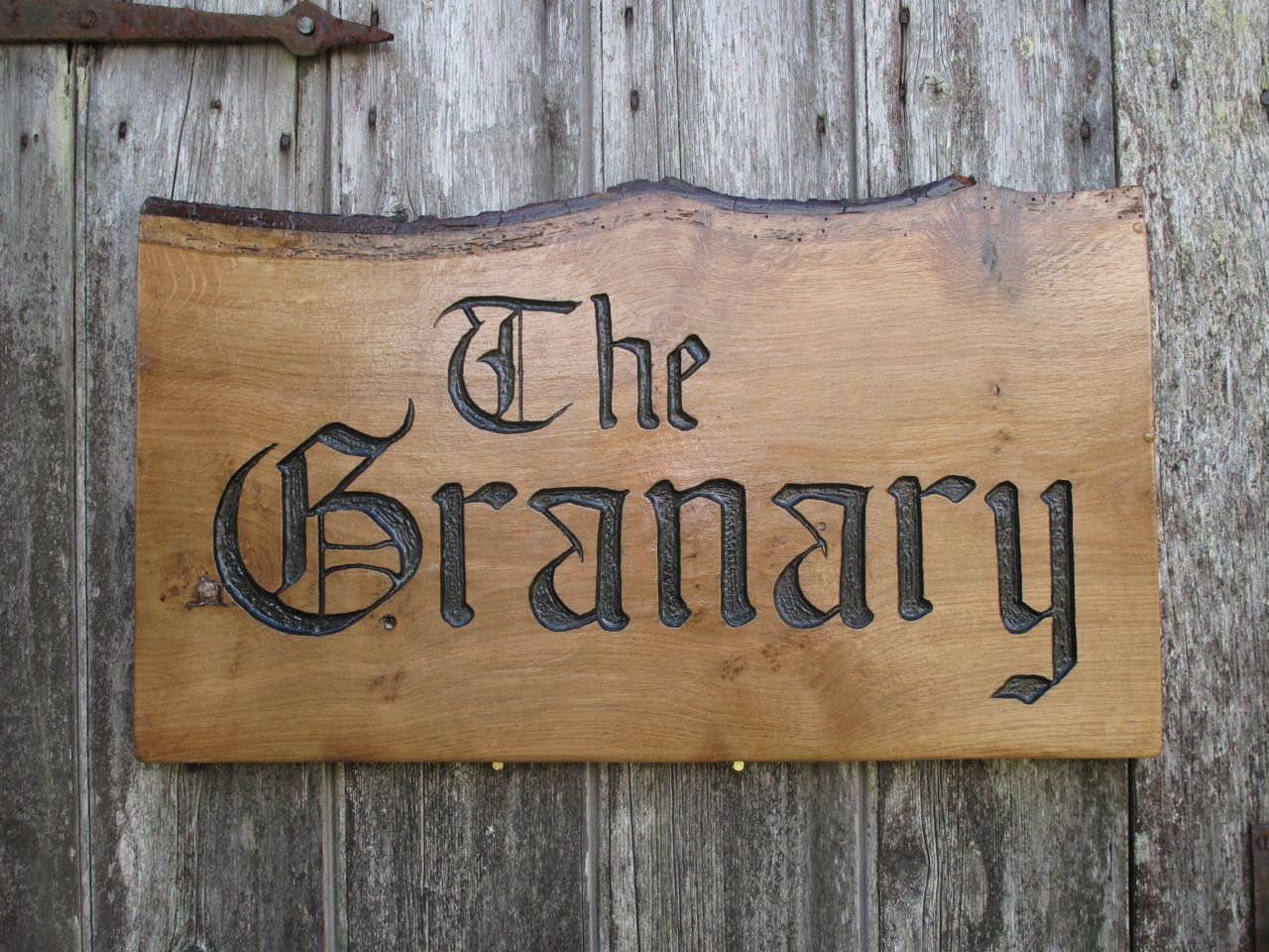 The granary carved wooden sign for old farmhouse