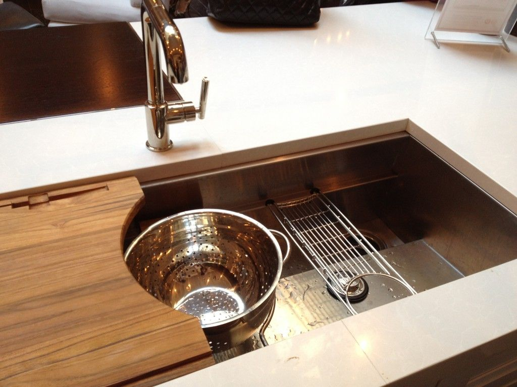 mick de giulio designed this sink for kallista some of its features include an offset drain to allow for more under sink storage a sliding cutting board