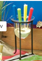 Fill your hurricane lamps or planters with beach sand and put some festive themed candles in them - great way to 'dress up' your surrounding while entertaining.  Intrigue Design sells these candles -