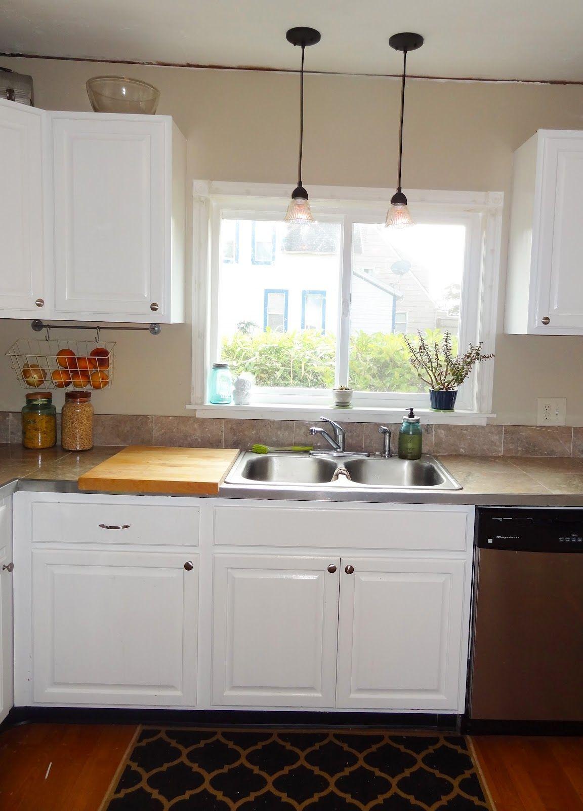 Sliding window over kitchen sink  hanging light over kitchen sink  sinhvienthienan