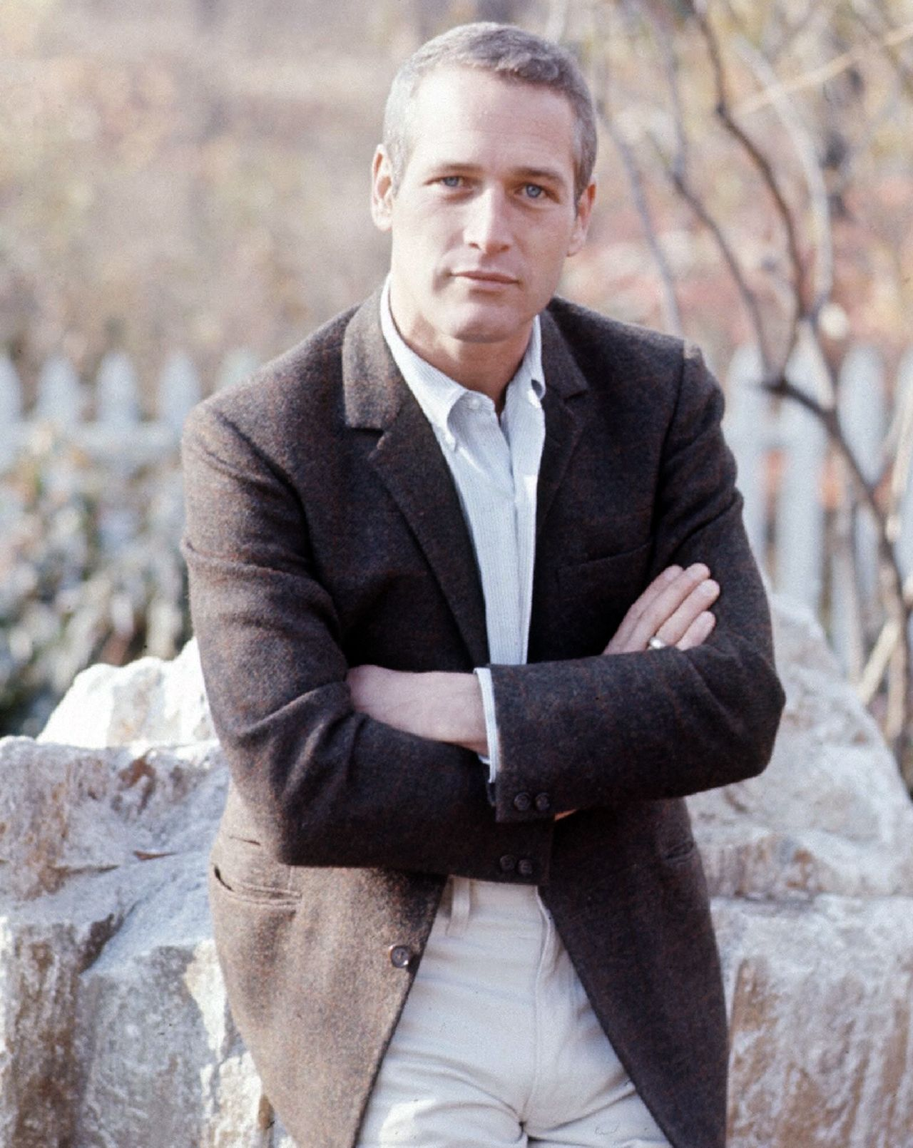 Paul Newman, 1967; ivy style brown tweed sportcoat, grey university-striped button-down shirt, tan whipcord 5-pocket trousers