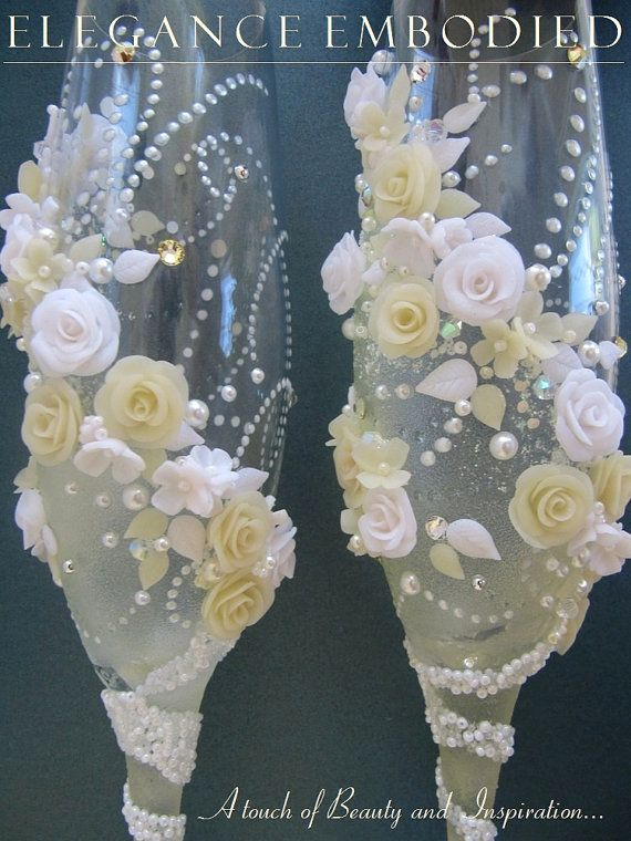 A beautiful white & champagne color wedding toasting flutes (swarovski crystals, faux pearls, polymer clay roses)