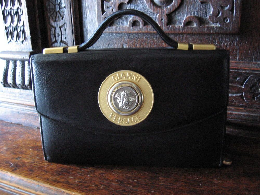 I bought this vintage GIANNI VERSACE Medusa Black Handbag years ago for a  bit of a trashy laugh but you can t fault it!....x 9f9b4e49ebe07
