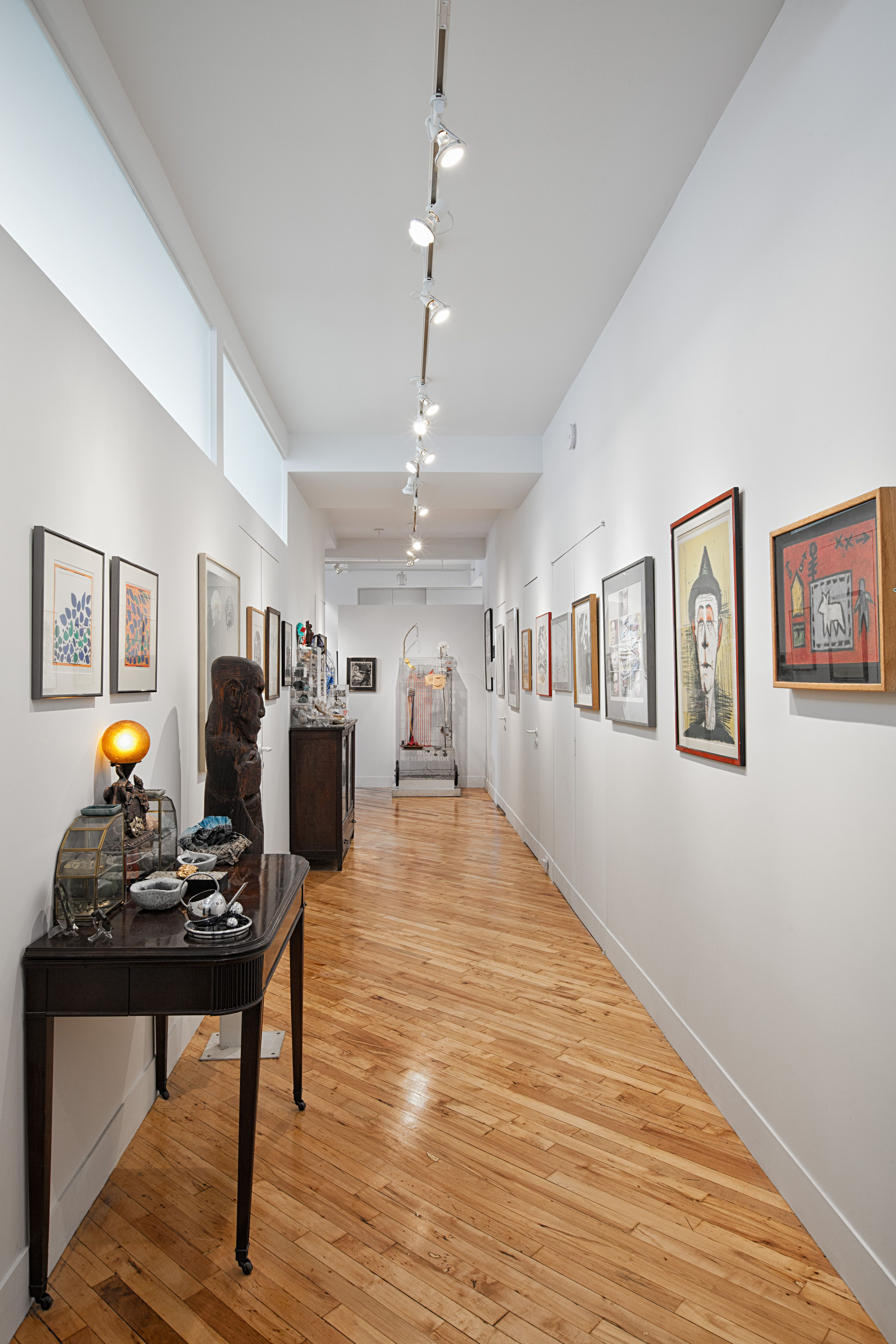 Hallway in artist s Manhattan loft hallway tables art paintings