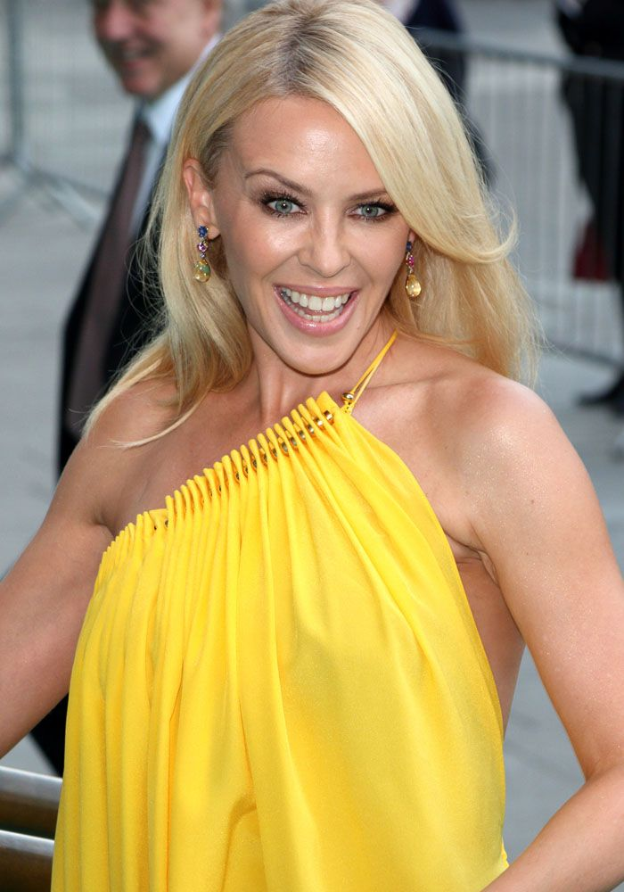 Kylie Minogue Twirls Around In Yellow Dress And Gold