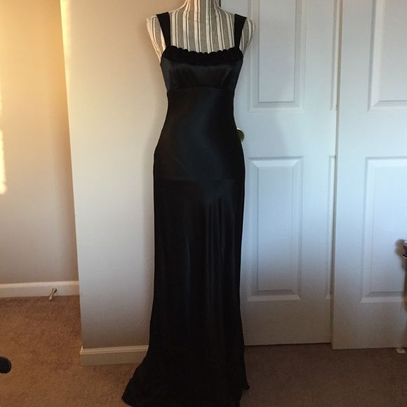 Beautiful black gown Beautiful gown, worn once to the Marine Corps Ball.  Zips in the back with a 3 loop cris cross tie just above the zipper.  Tag size is 7, but it's a small 7. Inxs Dresses