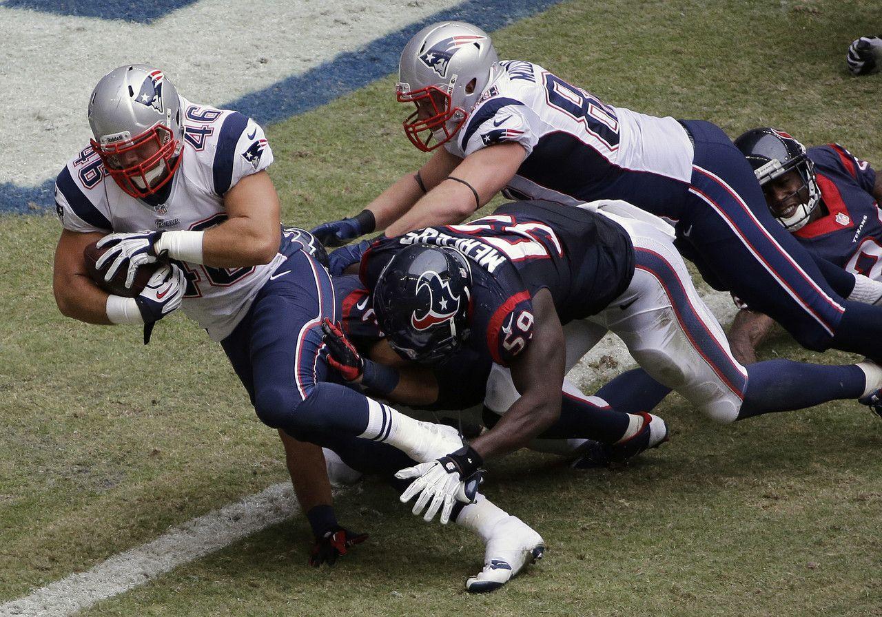 New England Patriots' James Develin (46) scores a