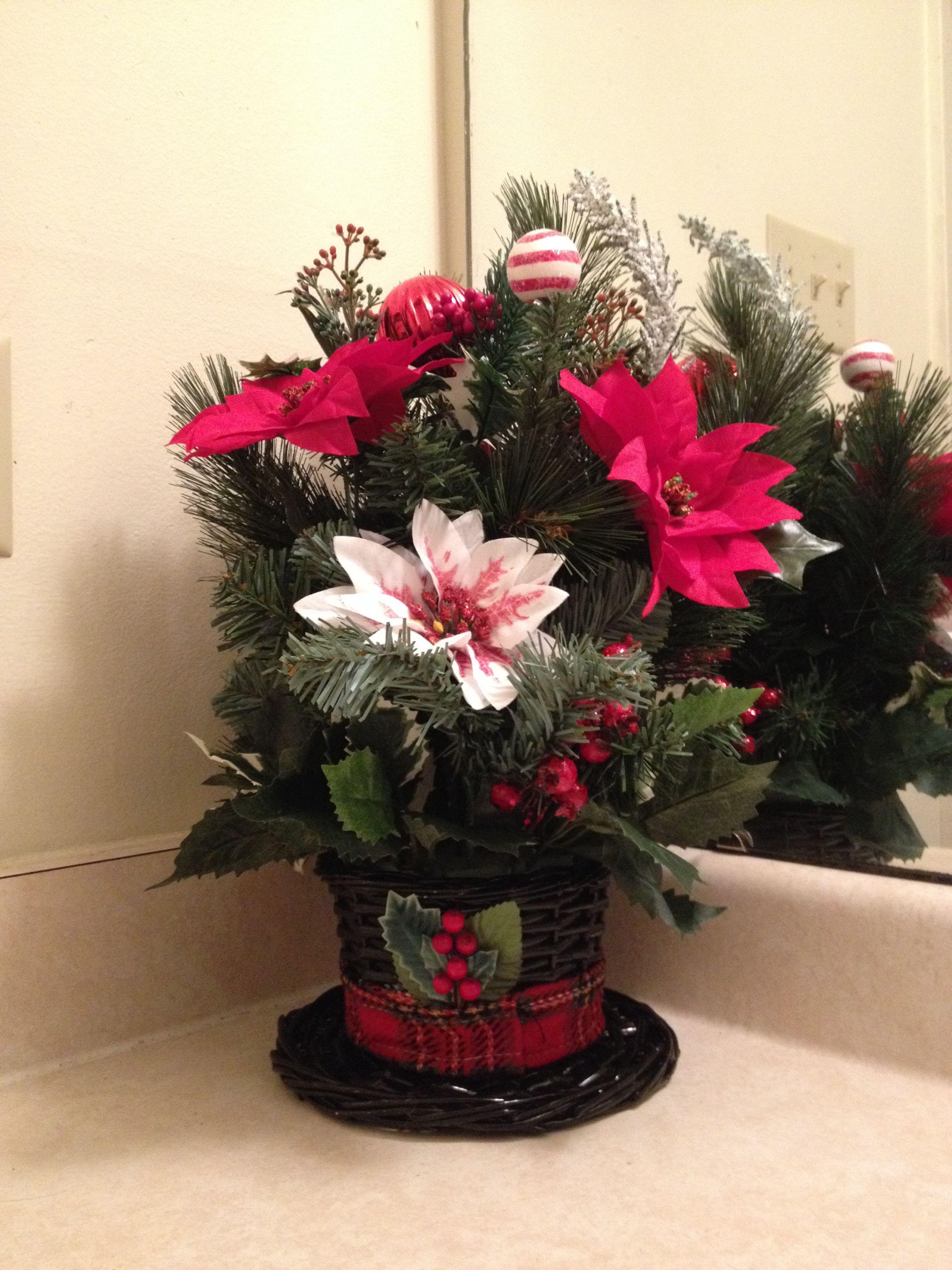 Snowman hat arrangement Christmas floral arrangements