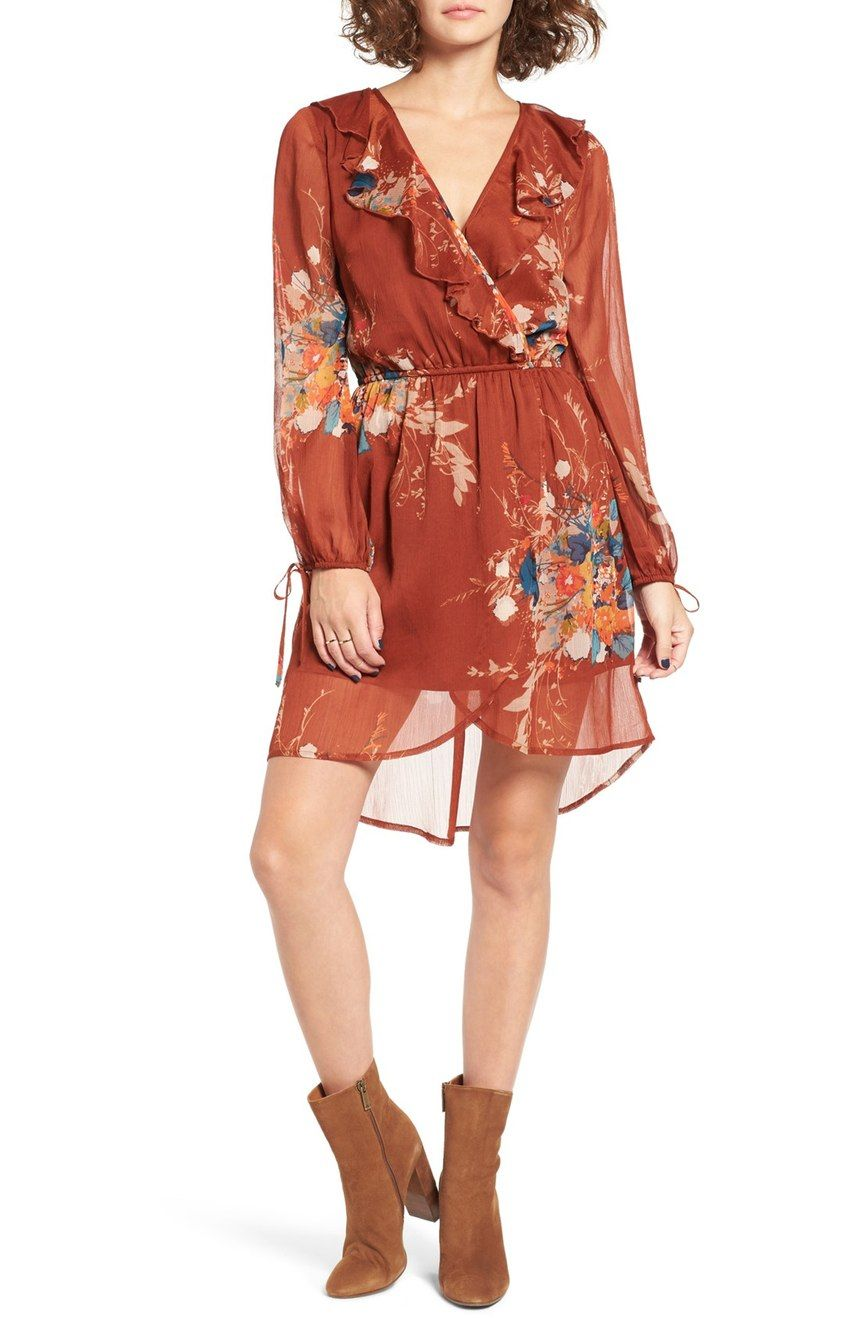 Lush autumnal bouquets float on a flirty chiffon dress with a ruffled surplice neckline, nipped-in waistline and sheer, billowy sleeves.