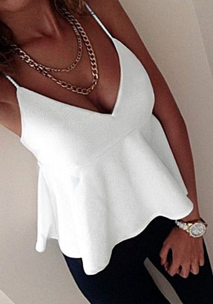 What's New // Enjoy the heat in style with this white empire-waist spaghetti-strap top.