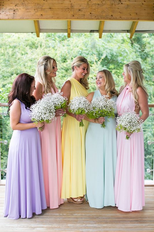 Pastel Bridesmaid Dresses And Baby S Breath Bouquets