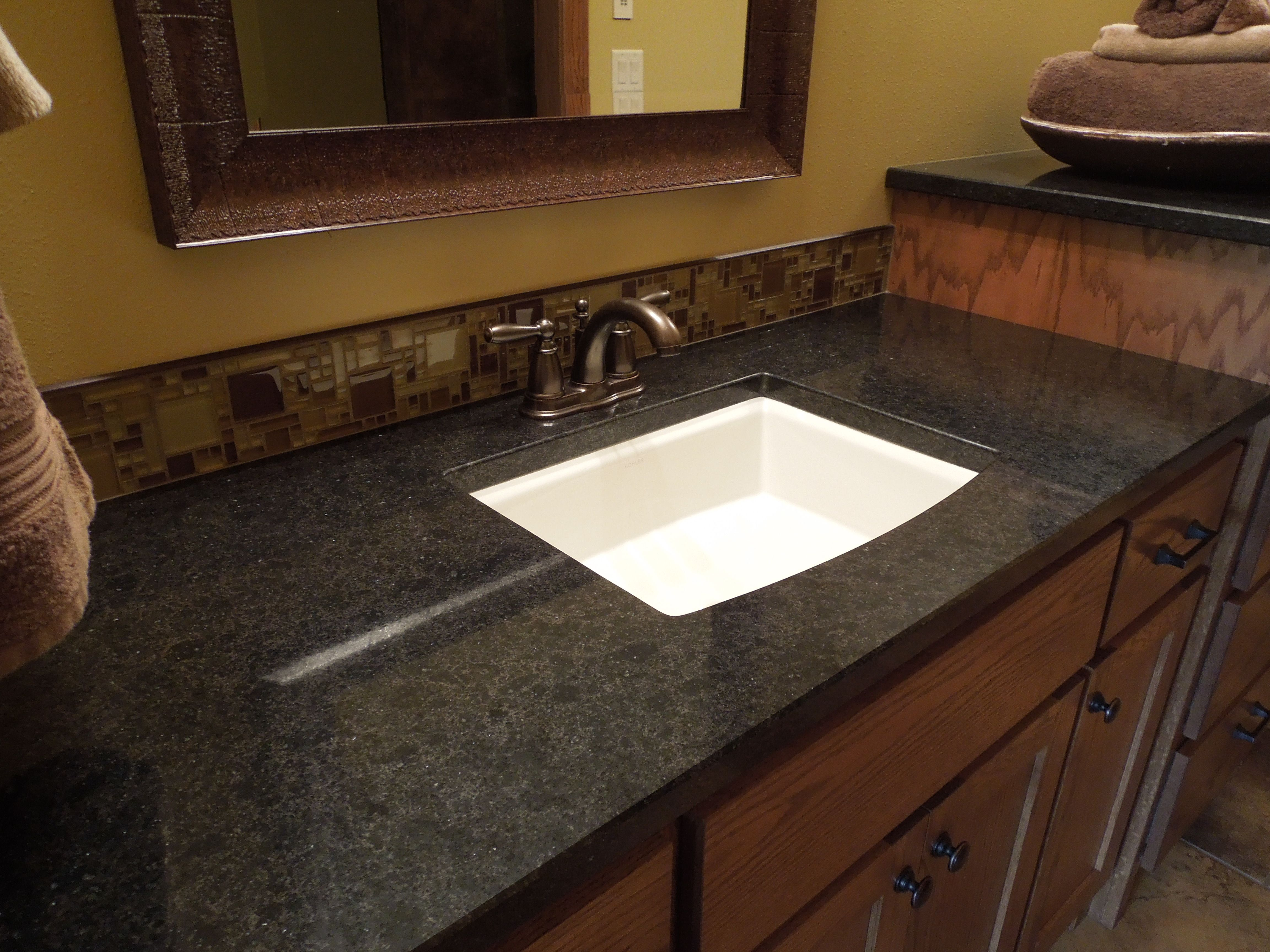 Countertop Trends for 2014 | Bathroom countertop design ... on Bathroom Ideas With Black Granite Countertops  id=79766