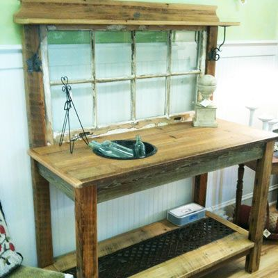 """This potting bench is made from a old window and heart pine beams and planks. The bottom shelf has an old cast iron park bench inset, and the top features an enamel pot."""""""