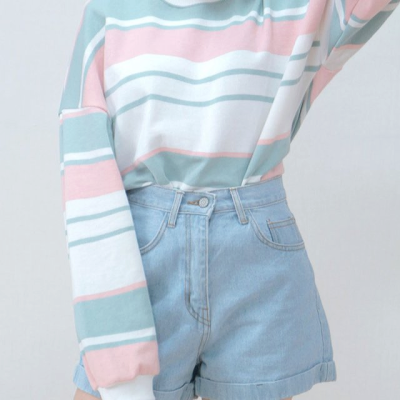 Pastel coloured outfit with high,waisted, baby blue shorts.