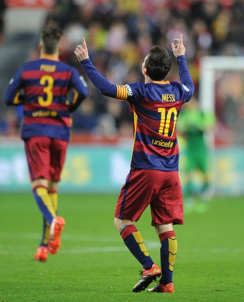 Lionel Messi of FC Barcelona celebrates after scoring his team's opening goal during the La Liga match between Sporting Gijon and FC Barcelona at Estadio El Molinon on February 17, 2016 in Gijon