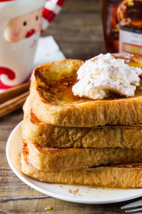 Eggnog French Toast is fluffy and soft with golden edges, a hint of nutmeg and delicious eggnog flavor. The perfect easy breakfast for the holidays!