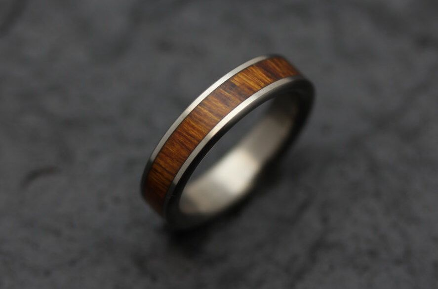 Wooden Wedding Band in Titanium and Arizona Desert Ironwood by MontyWinnfieldRings on Etsy https://www.etsy.com/listing/259537709/wooden-wedding-band-in-titanium-and