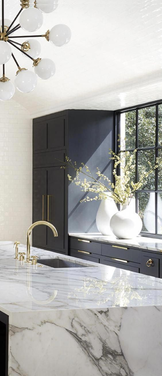 modern kitchen design with navy kitchen cabinets, white subway tile, and marble countertops, ... mo