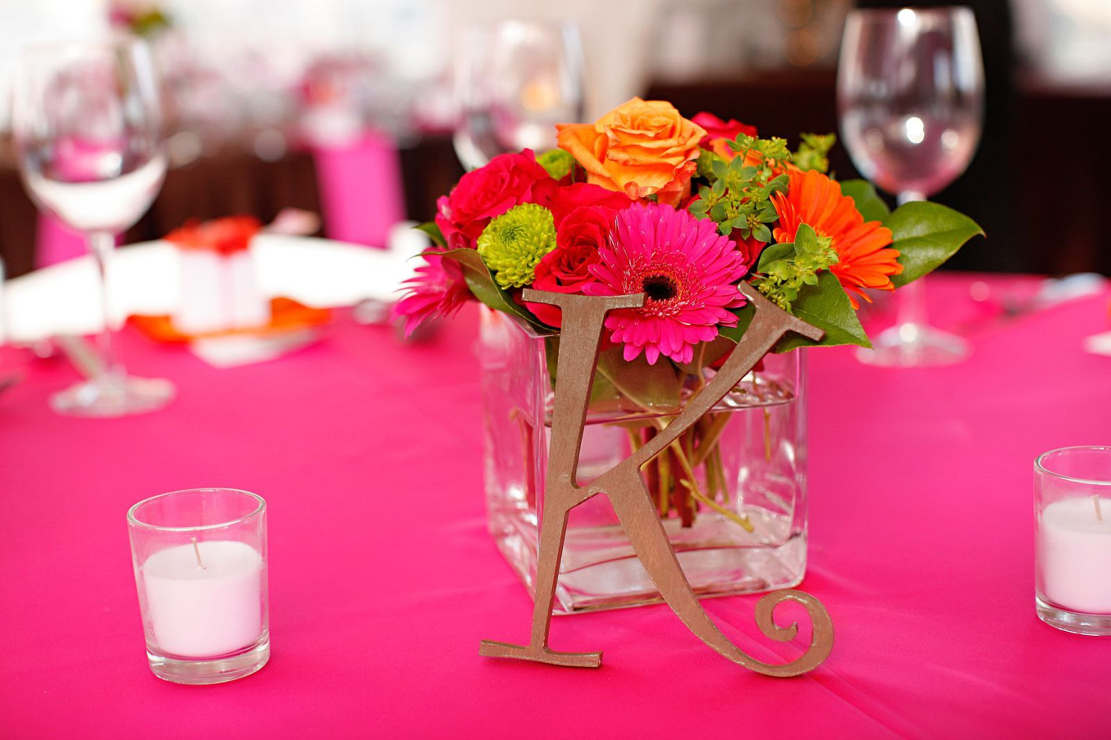 pink and orange centerpiece...letters to spell out the couple\'s last ...