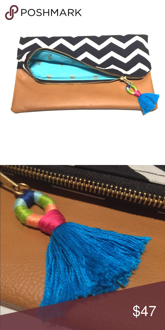 Handmade clutch This clutch is all handmade, including the tassel. The exterior fabric is black & white zigzag patter with a faux dark, taupe leather base. Inside is a turquoise pop of color with mini gold pineapples. Exposed zipper & pocket inside. Bags Clutches & Wristlets