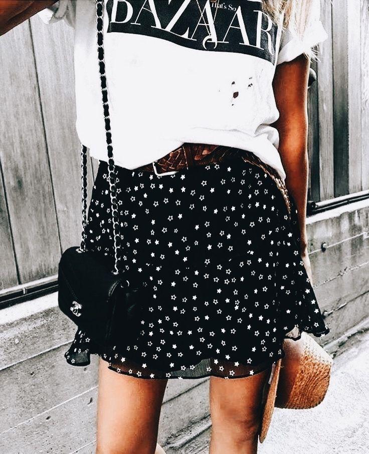 Photo of Logo tee with printed skirt and Chanel bag