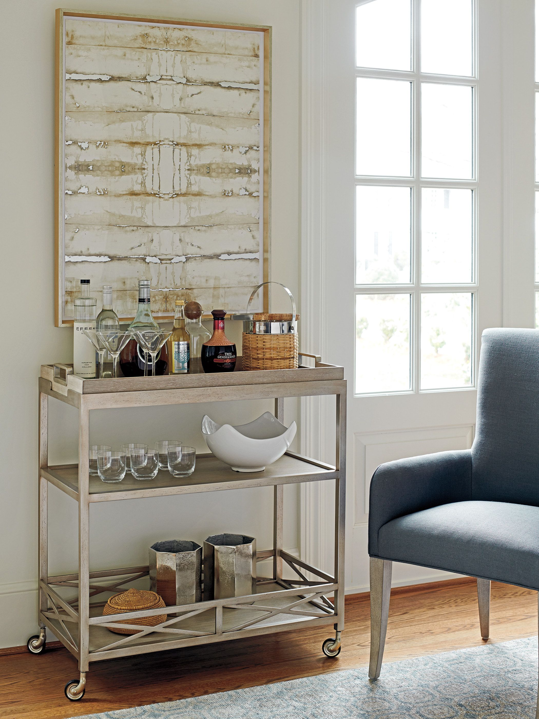 The Anacapa Metal Bar Cart from Barclay Butera would be a great transitional addition to your home.  The design of this transitional piece makes it a statement piece for years to come.  The quality paired with the natural finish makes for a quality piece of furniture.