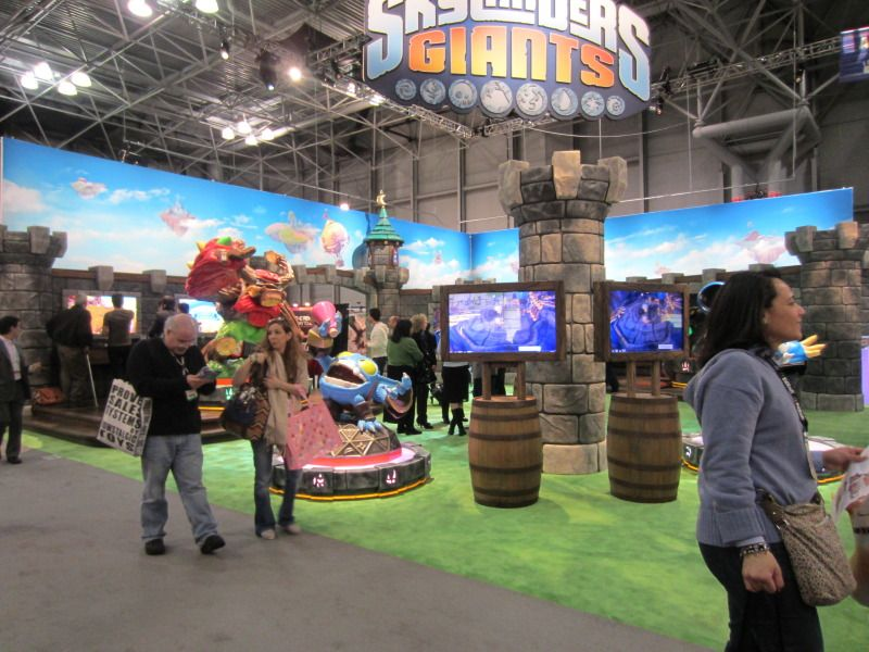 Skylanders Giants at the Toy Fair 2012. Showing new giants characters Tree-Rex & Alchemist in background.