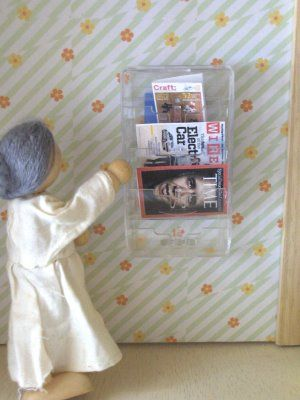 for doll houses... mini magazine rack... from a razor cartridge holder. Aha! I knew that I'd find a use for it someday!