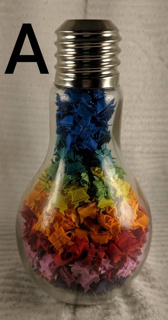 Photo of Decorative origami turtle filled glass jars  ROYGBIV assortment