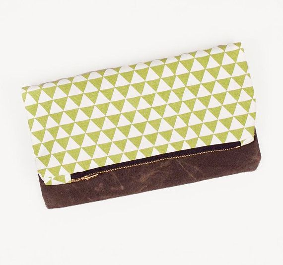 i can't decide which color/pattern i love the most!  Olive Triangle Clutch by londontierney on Etsy