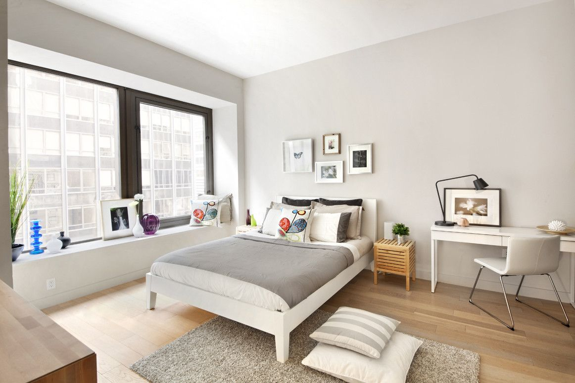 Beautiful minimalist room featuring ikea nordli bed and an ikea desk