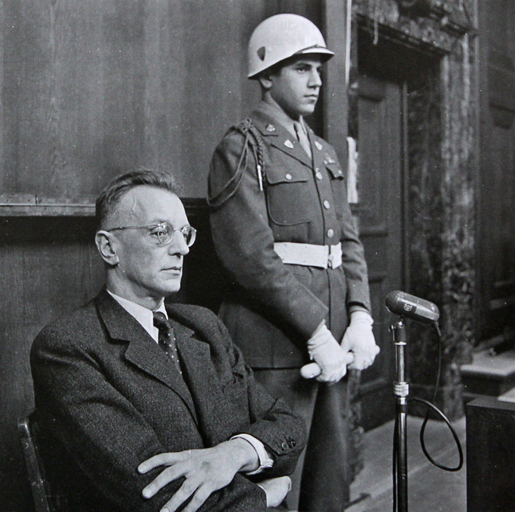 arthur seyss inquart at the nuremberg trials a guard  arthur seyss inquart at the nuremberg trials a guard 1946 he was a nazi lawyer who held high offices in and occupied and wa