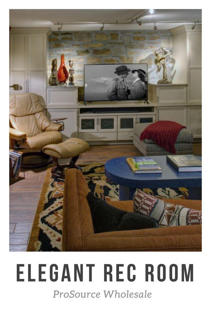 This elegant and comfortable media room includes custom builtin