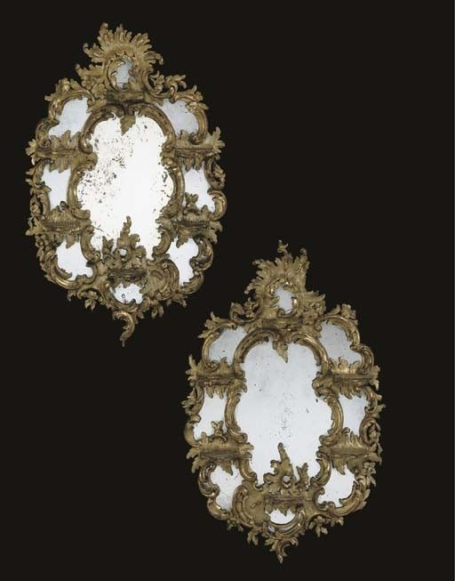 A PAIR OF GERMAN GILTWOOD ETAGERE MIRRORS