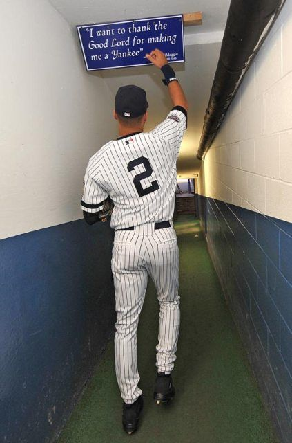 Derek Jeter tapping the iconic Joe Dimaggio quote sign in the dugout tunnel of the original Yankee Stadium. The sign was a piece of memorabilia that Jeter wanted to keep and managed to take before the stadium was demolished.