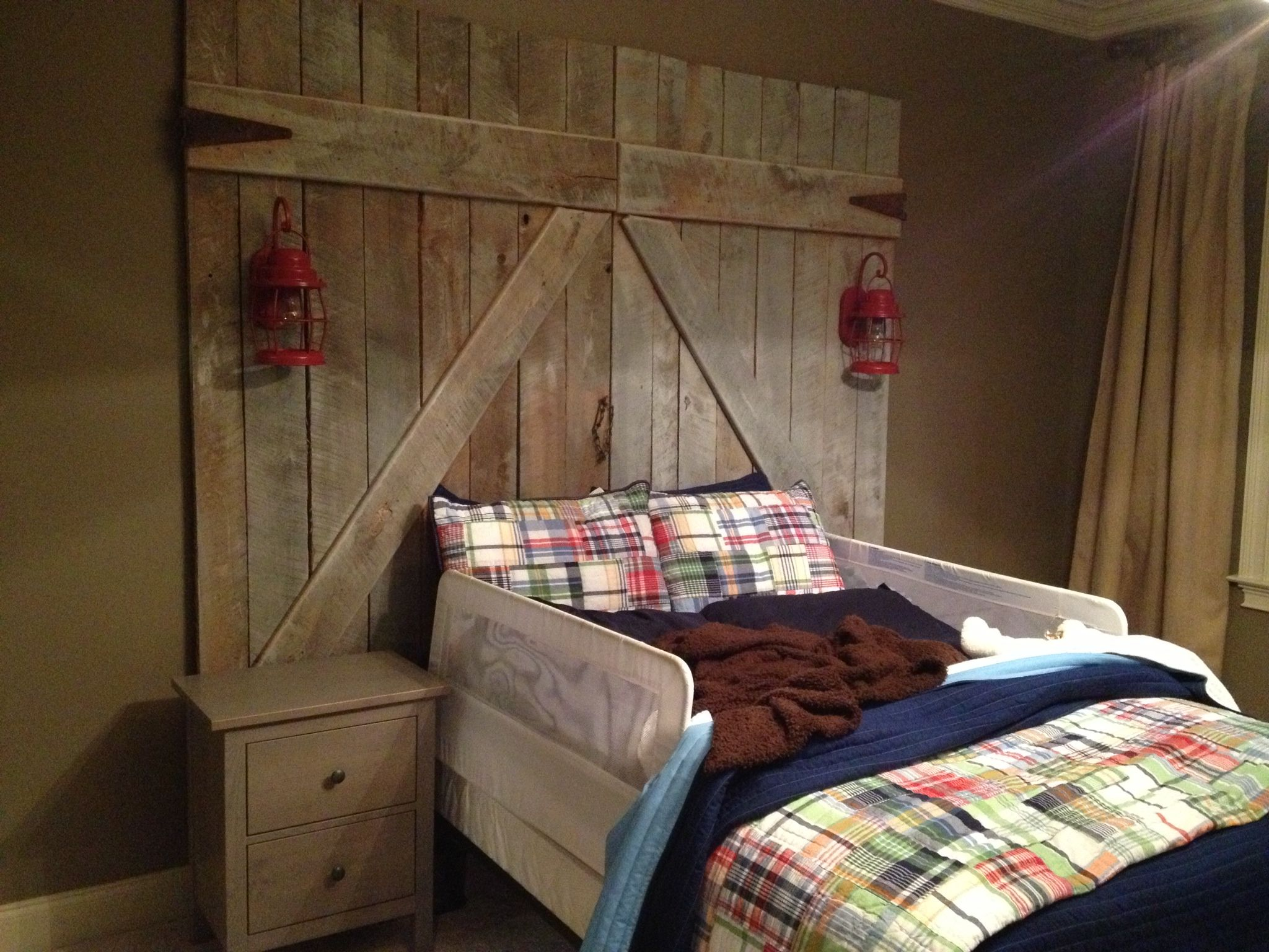 Barn door headboard for a toddler bed with wired Edison ...