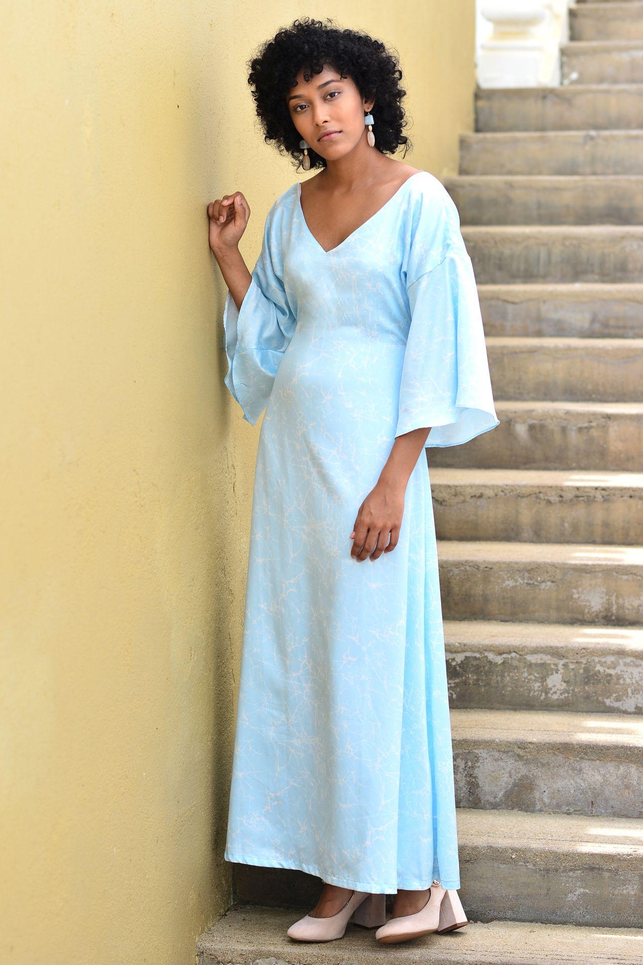 41473160dd The Cerulean Maxi has a subtle white crack print throughout the dress. This maxi  dress