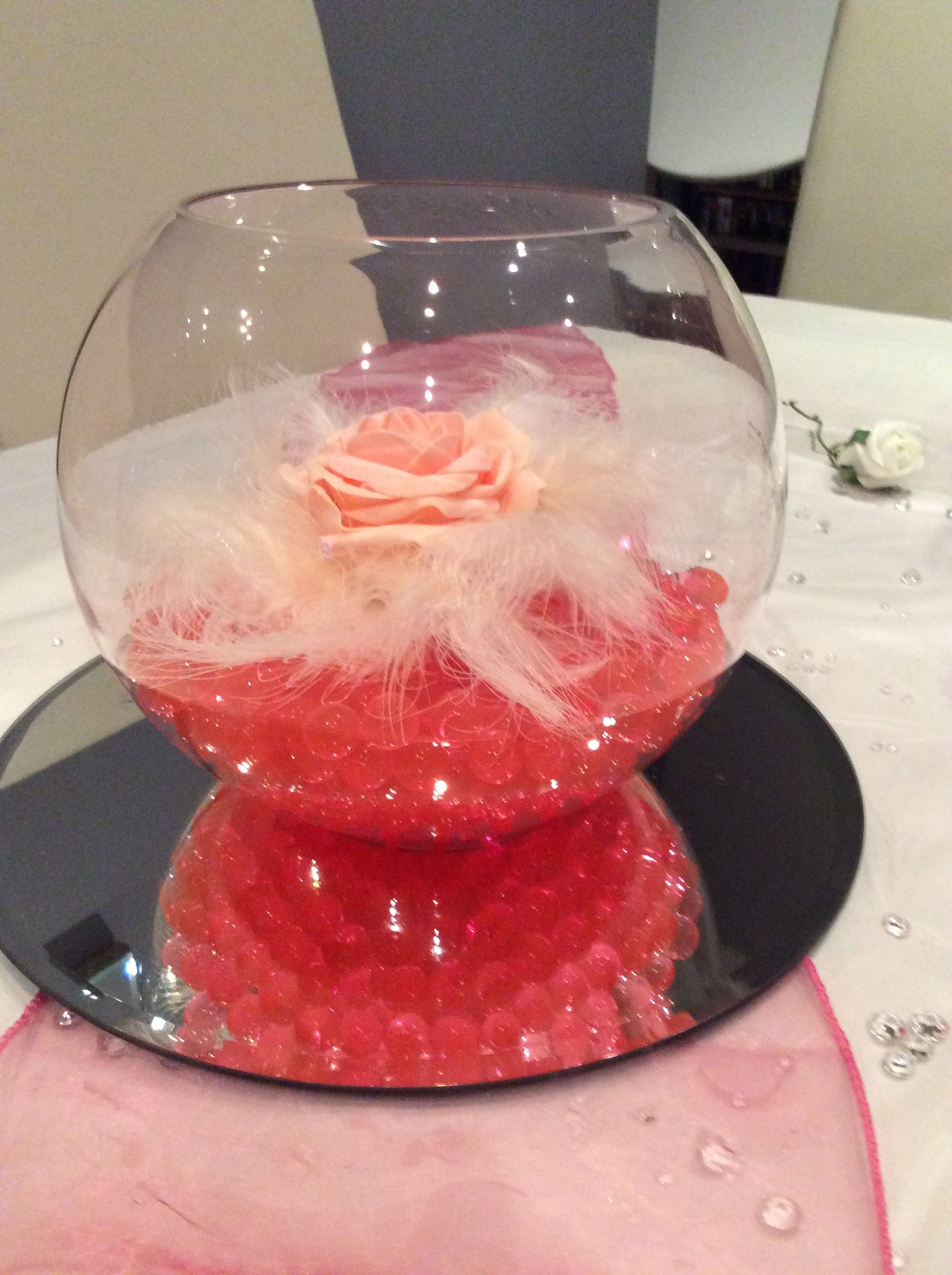 Fish Bowl Wedding Centrepiece For Pink Themed Weddings Hot Pink Beads Light Pink Rose And Feathers Avai Feather Centerpieces Pink Wedding Theme Wedding Hire