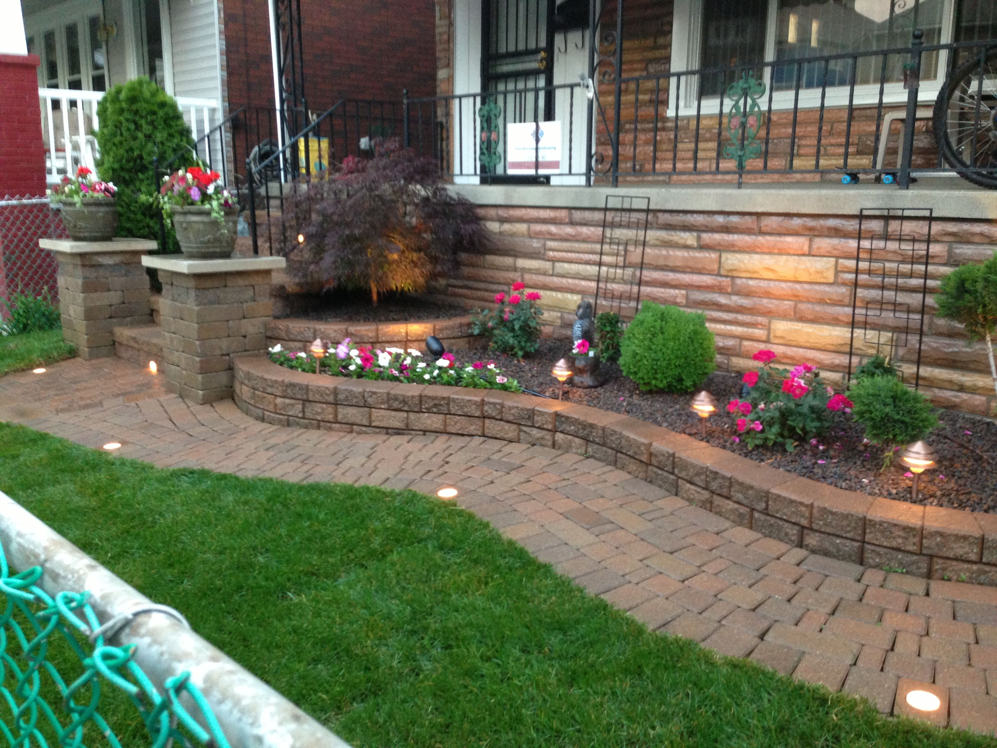 Raised flower bed with decorative stone and a japanese for Flower bed landscaping ideas