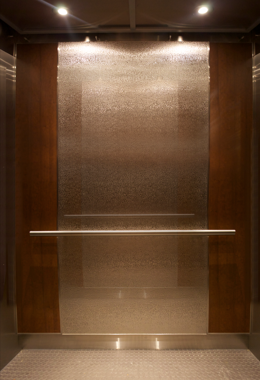 Following Trends This Elevator Interior Uses Rustic