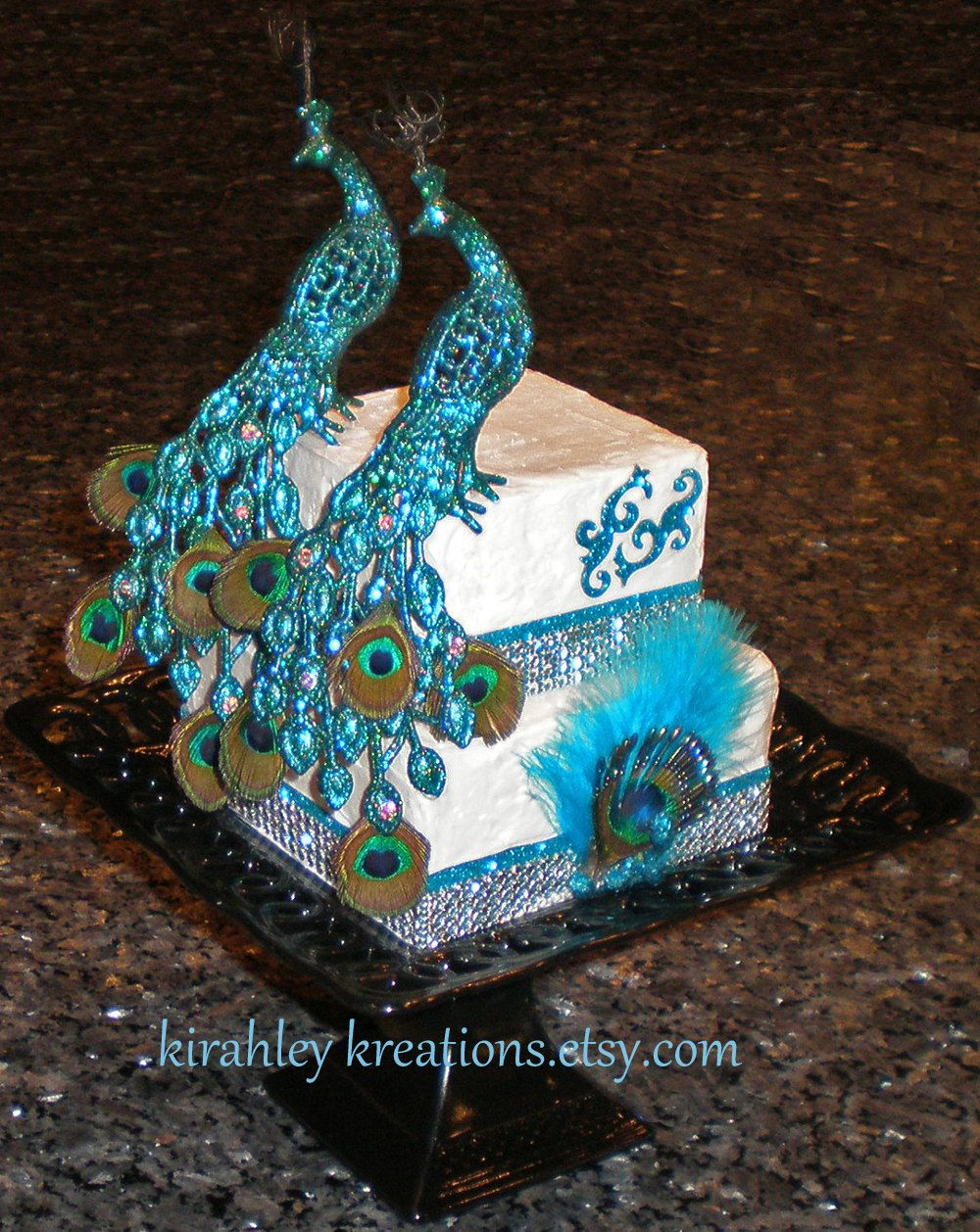 PEACOCK Wedding Cake Toppers -- Gorgeous & Glittery Iridescent Green w/ Mini Peacock Feathers, Curled Herl and Sparkling Swarovski Jewels. $64.00, via Etsy.