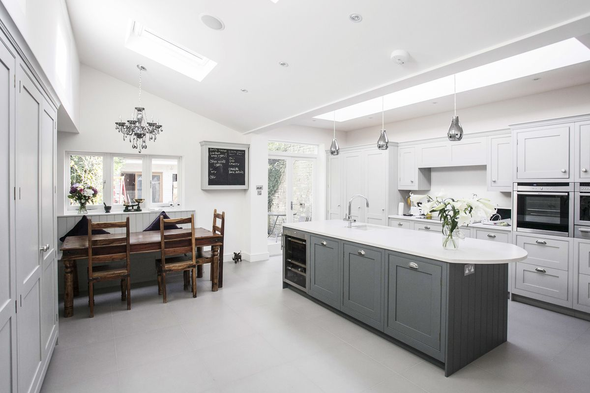 Burlanes kitchen with banquette seating facing kitchen island.jpg ...