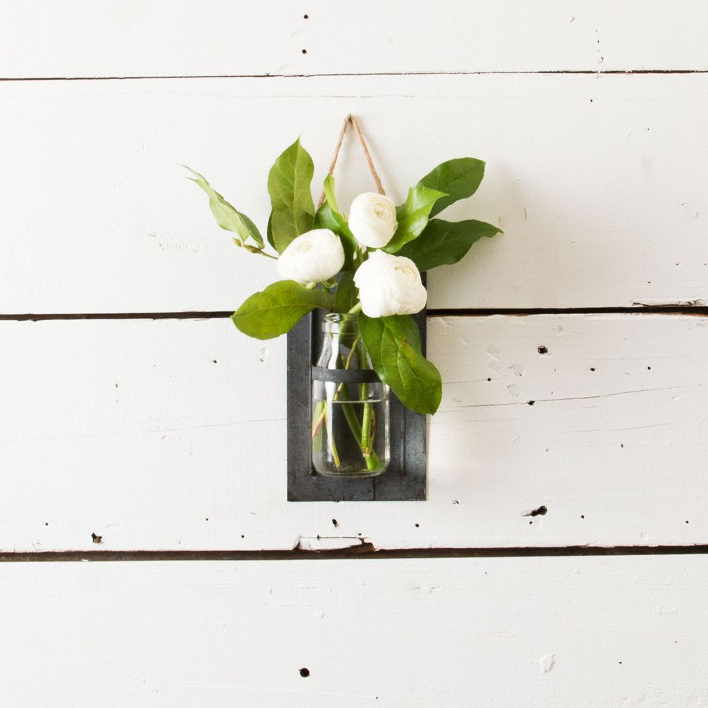 Hanging flower jar a simple glass milk jar resting in a hanging hanging flower jar a simple glass milk jar resting in a hanging galvanized metal frame adds the perfect accent to any wall joanna often displays seasonal reviewsmspy