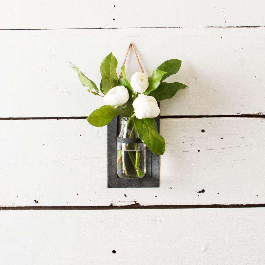 Hanging Flower Jar - A simple glass milk jar resting in a hanging  galvanized metal frame