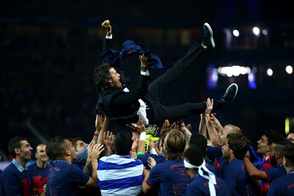 Luis Enrique manager of Barcelona is thrown in to the air by his players as they celebrate victory after the UEFA Champions League Final between Juventus and FC Barcelona at Olympiastadion on June 6, 2015 in Berlin, Germany.